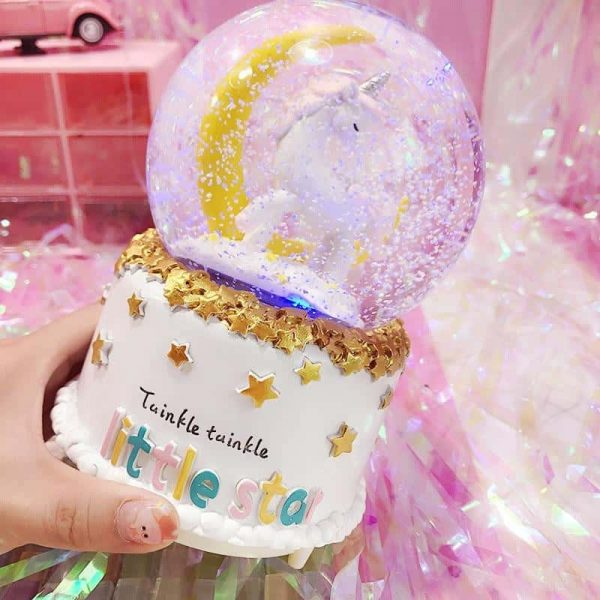 ball at snow unicorn musical tall bow in sky buy