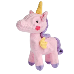 plush unicorn teddy at knitting pink child