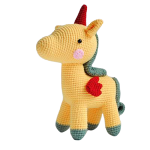 plush unicorn teddy at knitting yellow