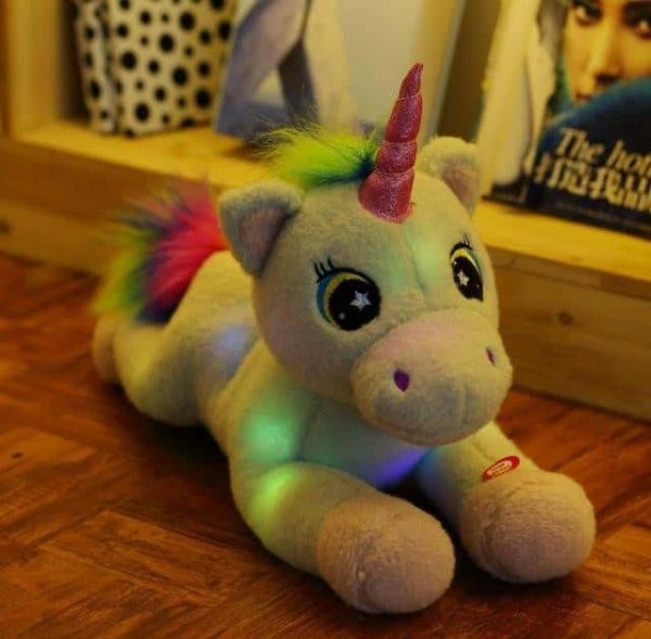plush unicorn who lights up bow in sky at sell