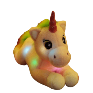 plush unicorn who lights up white child