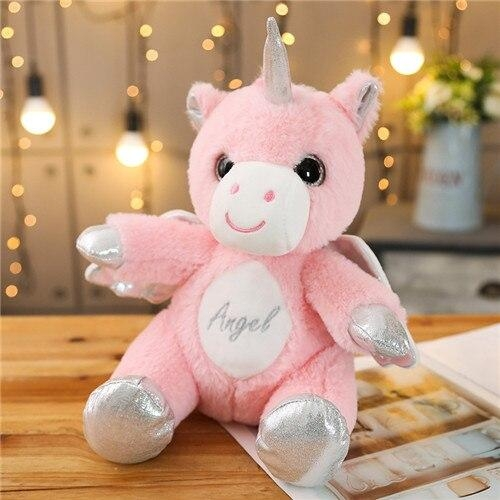plush unicorn with wing sitting down pink at sell